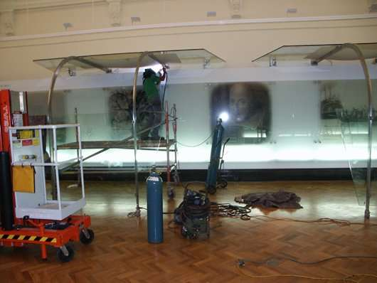 Installing glass graphic panels